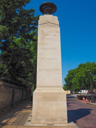 commemorate: Commonwealth Memorial Gates war memorial in Hyde Park Corner Constitution Hill to commemorate the armed forces of the British Empire who served for Britain in First and Second World Wars in London, UK