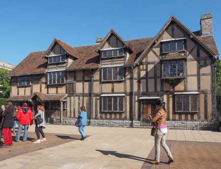 william shakespeare: STRATFORD UPON AVON, UK - SEPTEMBER 26, 2015: Tourists in front of William Shakespeare birthplace