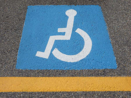 disabled parking sign: Disabled parking sign in reserved parking lot Stock Photo