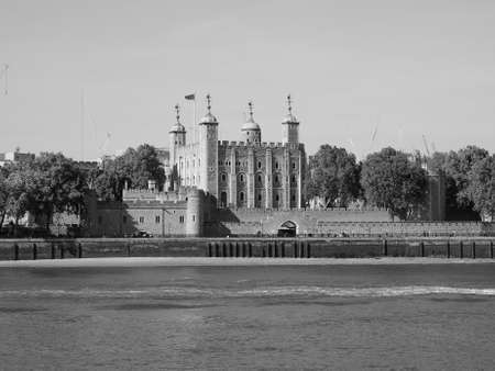 river thames: The Tower of London seen from River Thames in London, UK in black and white