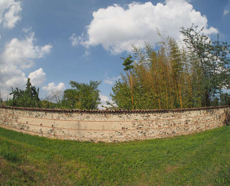 seen: Ancient stone and brick wall seen with fisheye lens Stock Photo