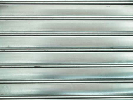 corrugated steel: Corrugated steel sheet useful as a background - cool cold tone Stock Photo