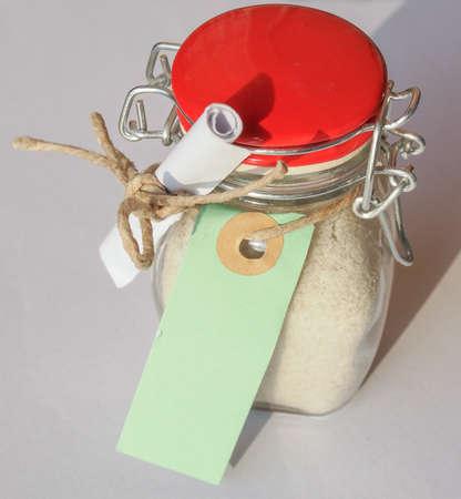 bath salts: Jar of Bath salts crystalline substance to soften or perfume bath water, with blank tag Stock Photo