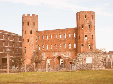 palatine: Vintage looking Palatine towers Porte Palatine ruins of ancient roman town gates and wall in Turin