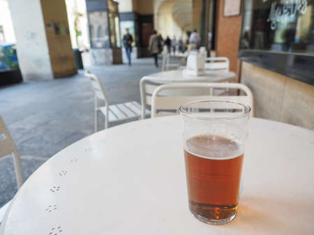 alfresco: A pint of British ale beer on a table at alfresco bar