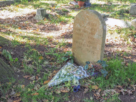 churchyard: TANWORTH IN ARDEN, UK - SEPTEMBER 25, 2015: Grave of English musician Nick Drake in the churchyard of St Mary Magdalene church