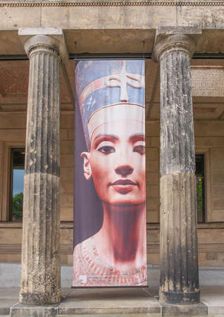 queen nefertiti: BERLIN, GERMANY - MAY 10, 2014: Banner of Queen Nefertiti of Egypt (known as Nofretete in German) in front of the Neues Museum which hosts her statue