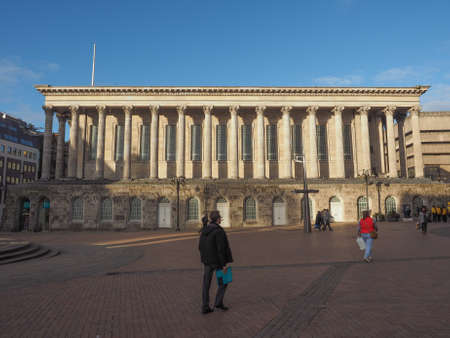 municipal editorial: BIRMINGHAM, UK - SEPTEMBER 25, 2015: Tourists in front of Town Hall concert venue Editorial