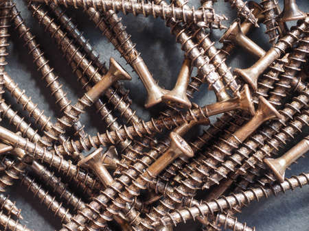 helical: Many bronze screws for wood Stock Photo