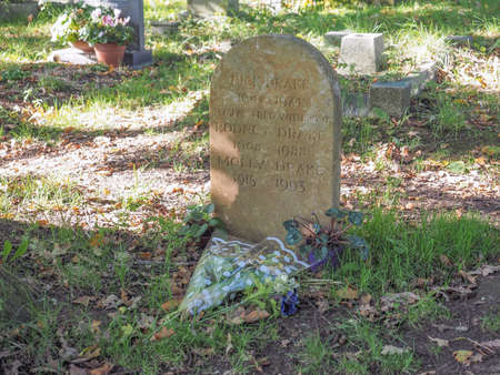 st nick: TANWORTH IN ARDEN, UK - SEPTEMBER 25, 2015: Grave of English musician Nick Drake in the churchyard of St Mary Magdalene church