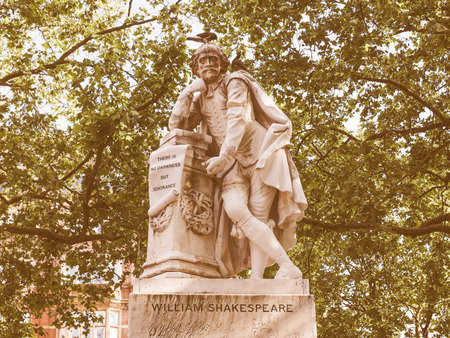 leicester: Vintage looking Statue of William Shakespeare built in 1874 in Leicester Square in London, UK Stock Photo