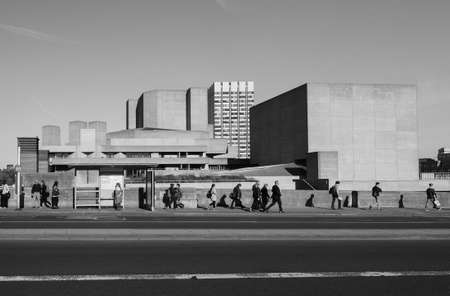 sir: LONDON, UK - NOVEMBER 17, 2015: People in front of the National Theatre designed by Sir Denys Lasdun, a masterpiece of new brutalist architecture Editorial