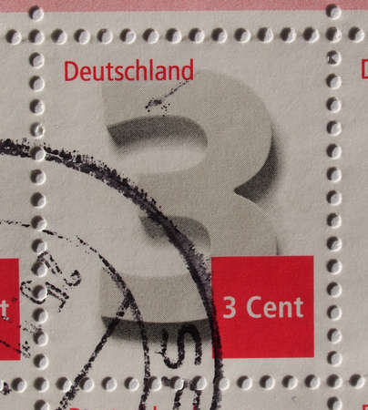 BERLIN, GERMANY - NOVEMBER 27, 2015: A 3 cent stamp, regular series, printed by Germany shows a large number 3