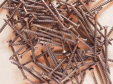 metal fastener: Many bronze screws for wood Stock Photo