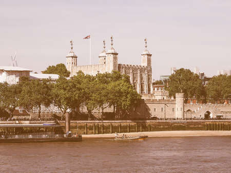 dungeons: Vintage looking The Tower of London seen from River Thames in London, UK Stock Photo