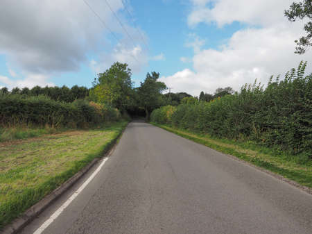 warwickshire: Road in the English countryside in Tanworth in Arden Warwickshire, UK