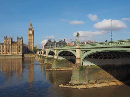 river thames: Westminster Bridge over River Thames with Houses of Parliament and Big Ben in London, UK