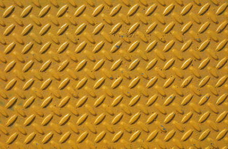 Yellow steel diamond plate useful as a background