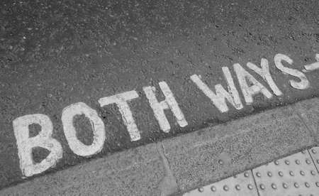 both: Look both ways sign in a London street in black and white Stock Photo