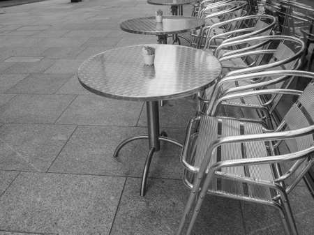 alfresco: Tables and chairs of a dehors alfresco bar restaurant pub in black and white