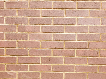 Vintage looking Red brick wall useful as a background