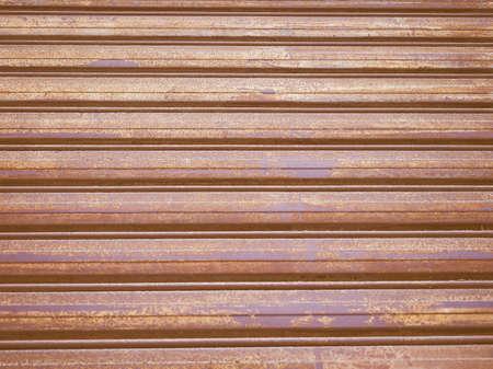 sectional door: Vintage looking Metal roller shutter door useful as a background Stock Photo
