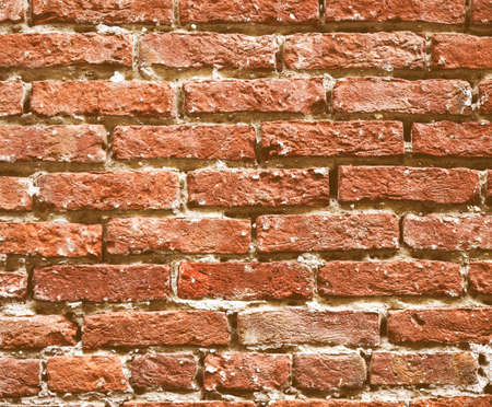 medioeval: Vintage looking Old brick wall useful as a background