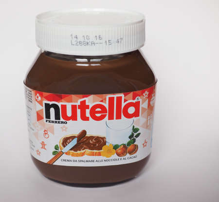 ferrero: ALBA, ITALY - CIRCA DECEMBER 2015: Jar of Italian Nutella hazelnuts cream made by Ferrero