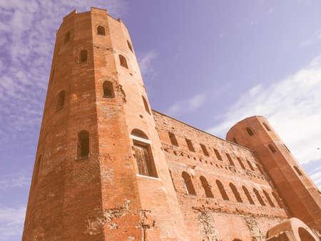 palatine: Vintage looking Palatine towers Porte Palatine ruins of ancient roman town gates in Turin