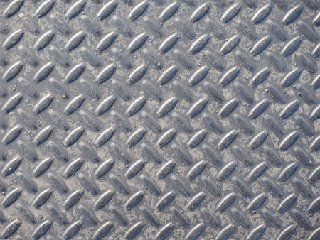 Grey steel diamond plate useful as a background Stock Photo