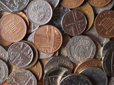 uk money: British Pound coins currency of the United Kingdom