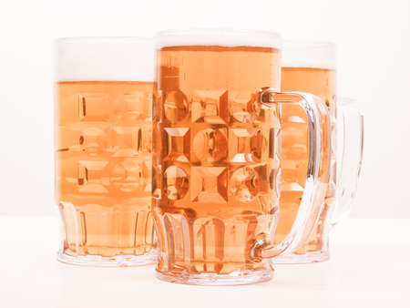 bier: Many large glasses of German lager beer vintage Stock Photo