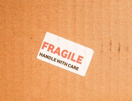 Fragile warning sign label tag on a cardboard box vintage Stock Photo