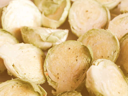 brussel: Vintage looking Brussel sprouts mini cabbages vegetables food background Stock Photo