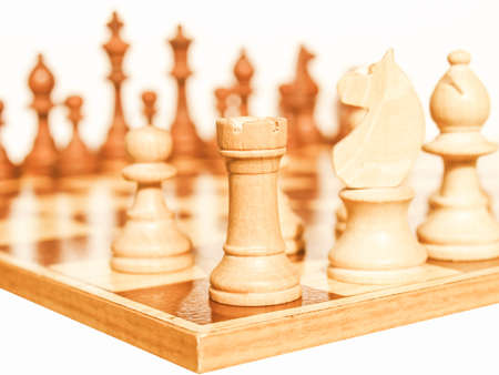 checkers: Wooden chessboard with light and dark wood checkers vintage