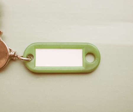 keyring: Green key ring with blank paper label with copy space vintage Stock Photo