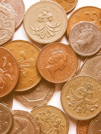 spendings: Detail of British Pound GBP coins money vintage Stock Photo