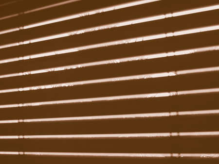 seen: Silhouette of windows blinds seen from a dark room against the sun light vintage Stock Photo