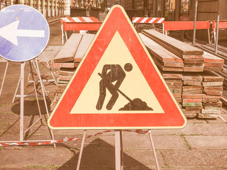 road works: Warning signs, Road works traffic sign in a building site vintage Stock Photo