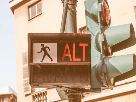 trafficlight: Traffic light for pedestrian crossing showing Alt sign in red meaning Stop vintage Stock Photo