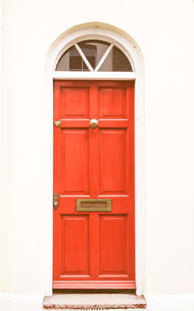 english house: Brightly coloured traditional English house door in London vintage Stock Photo