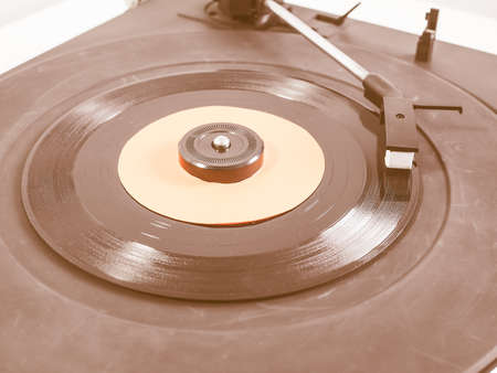 record player: Vinyl record on a turntable record player, single 45rpm disc vintage Stock Photo