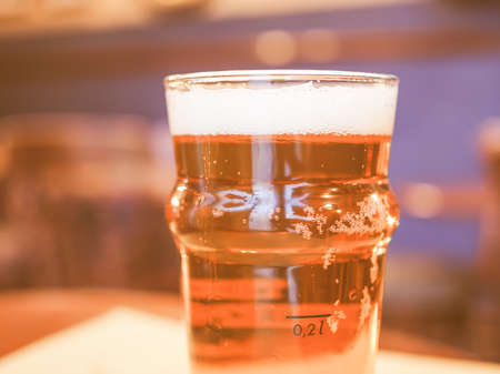 alcoholic drink: A pint of British ale beer alcoholic drink in a pub vintage Stock Photo
