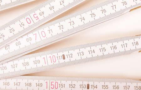 wooden metre: Wooden carpenter ruler for measurements in building site vintage