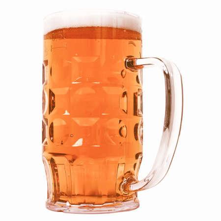 litre: Large German bierkrug beer mug tankard glass, half litre, one pint of dark beer - isolated over white background vintage Stock Photo
