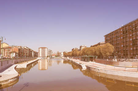 known: Vintage looking MILAN, ITALY - MARCH 28, 2015: The City harbor known as La Darsena is being redeveloped as part of the Expo Milano 2015 international exhibition