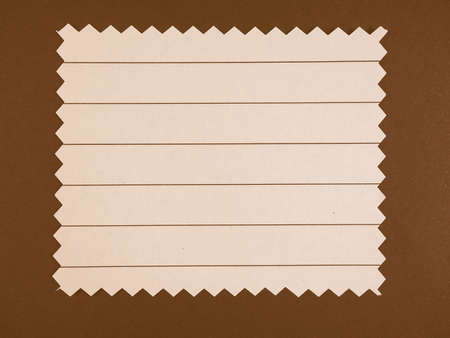 zig zag: Brown paper swatch with zig zag border cut with pinking shears vintage