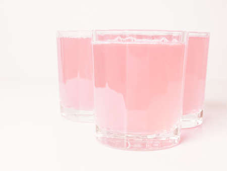 continental breakfast: Pink grapefruit juice glasses on continental breakfast table vintage Stock Photo