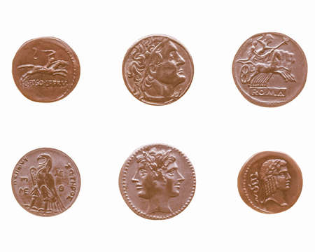 greek coins: Ancient Roman and Greek coins isolated over white vintage Stock Photo