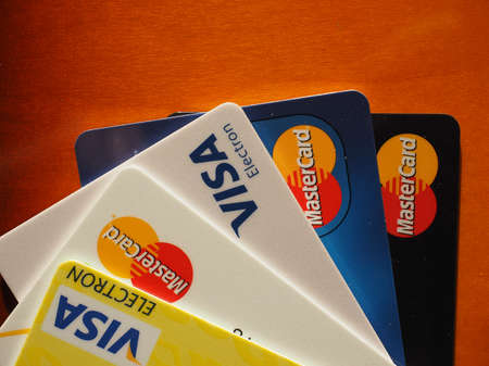 december 25: LONDON, UK - DECEMBER 25, 2015: MasterCard and Visa credit cards on wooden table Editorial